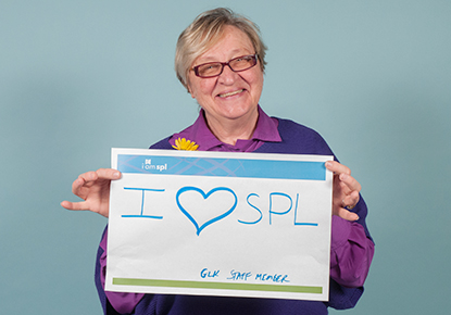 library staff holding sign saying I love SPL