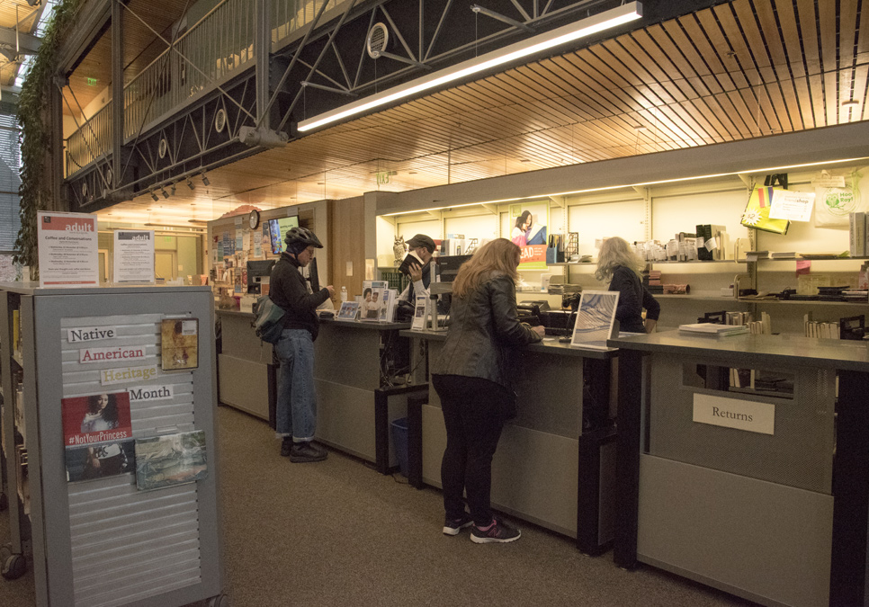 Library patrons at service desk area at the Capitol Hill Branch