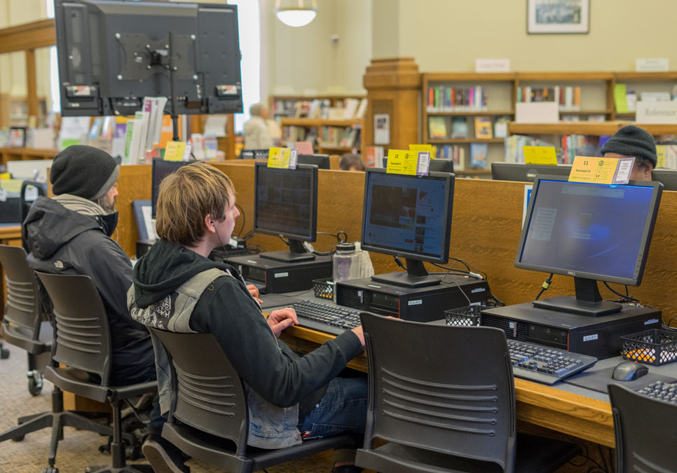 Library patrons using public computers at the Green Lake Branch