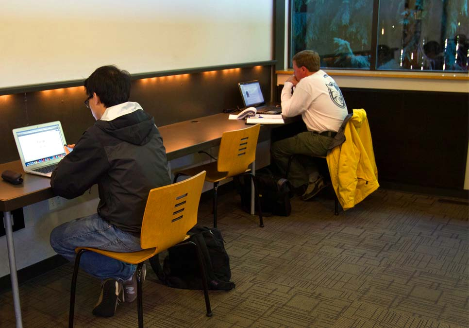Library patrons using laptops at the Northeast Branch