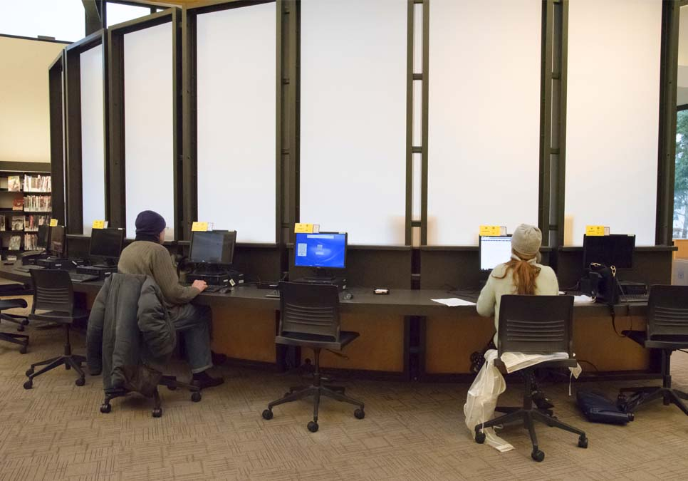 Library patrons using public computers at the Northeast Branch