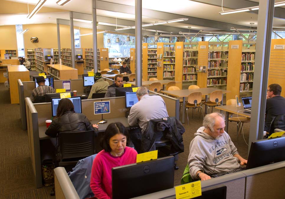 Library patrons using public computers at the Southwest Branch