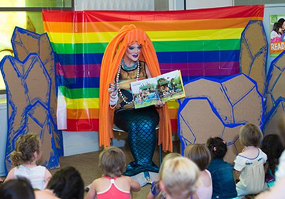Drag queen reading to kids at Rainbow Story Time